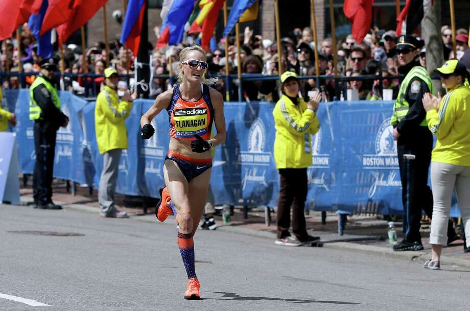 FILE - In this April 15, 2013, file photo, Shalane Flanagan approaches the finish line to finish fourth in the women's division of the Boston Marathon in Boston. Flanagan is more determined than ever to win the race for her battered hometown. The Marblehead, Mass., native would be the first American winner since 1985. (AP Photo/Elise Amendola, File) ORG XMIT: NY152 Photo: Elise Amendola / AP