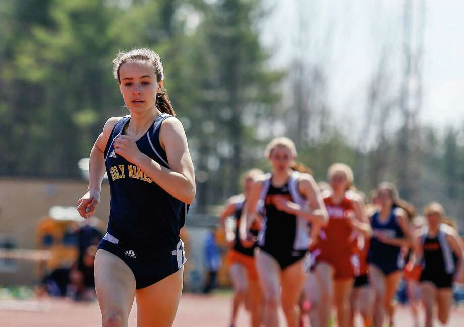 Leah Triller of Holy Names pulls ahead in the 1000m during the Lady Eagles Invitational outdoor track meet at Bethlehem High School, Saturday, April 19, 2014 in Delmar, N.Y. (Dan Little/Special to the Times Union) ORG XMIT: 00026535A Photo: Dan Little / Copyright Dan Little