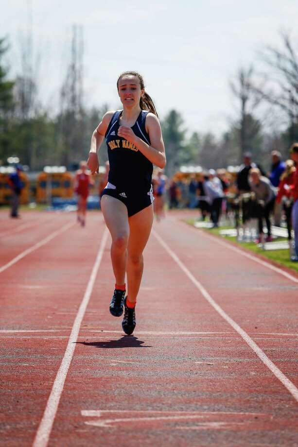 Leah Triller of Holy Names pulls ahead to win the 1000m during the Lady Eagles Invitational outdoor track meet at Bethlehem High School, Saturday, April 19, 2014 in Delmar, N.Y. (Dan Little/Special to the Times Union) ORG XMIT: 00026535A Photo: Dan Little / Copyright Dan Little