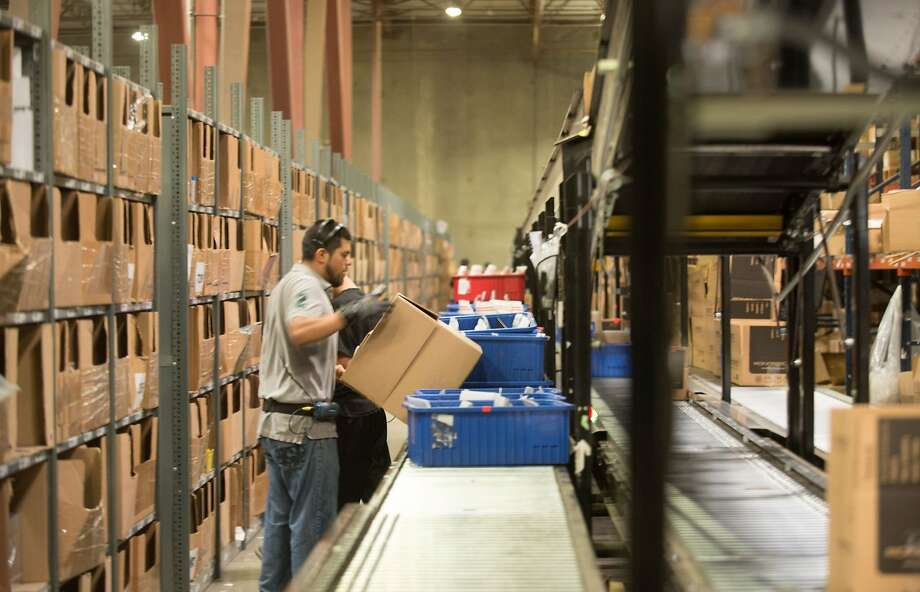 A worker prepares a shipment of merchandise ordered through Monoprice in San Bernardino County, which offers its own branded products at far less than comparable items elsewhere. Photo: Eugene Garcia,, McClatchy-Tribune News Service