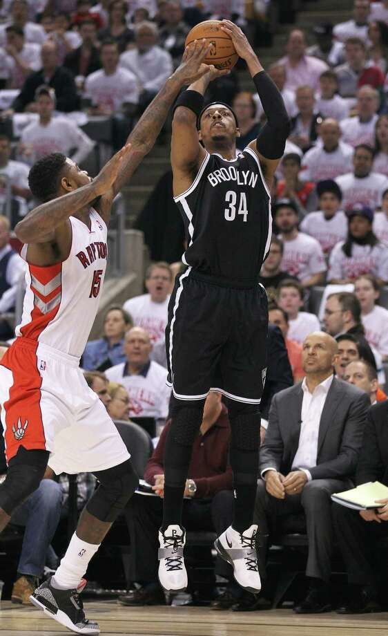 TORONTO, ON - APRIL 19:  Paul Pierce #34 of the Brooklyn Nets shoot a three point shot against the Toronto Raptors in Game One of the NBA Eastern Conference play-off at the Air Canada Centre on April 19, 2014 in Toronto, Ontario, Canada. The Nets defeated the Raptors 94-87 to take a 1-0 series lead. (Photo by Claus Andersen/Getty Images) ORG XMIT: 485874231 Photo: Claus Andersen / 2014 Getty Images