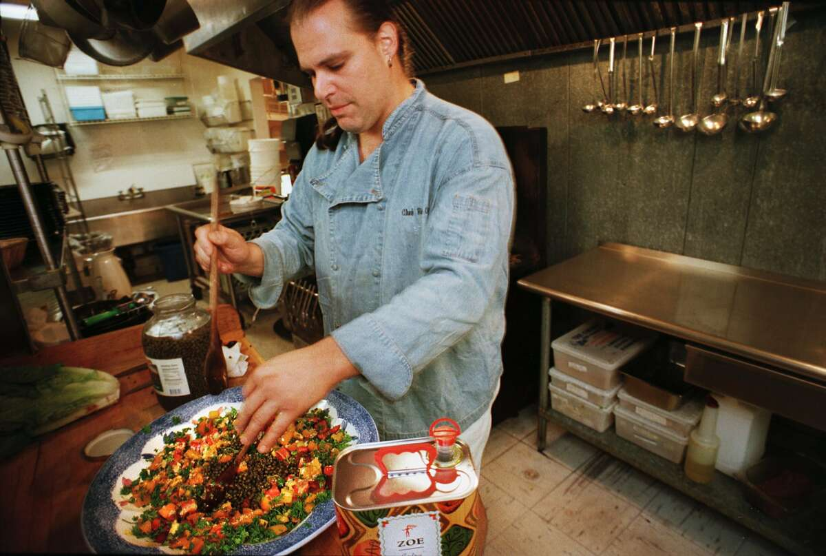 Special to the Times Union photo by Paul Buckowski -- Ric Orlando, co-owner of New World Home Cooking, fixes a puttanesca fresca sauce with heirloom tomatoes in the kitchen of the restaurant on Tuesday, July 27, 1999 in Woodstock, NY.