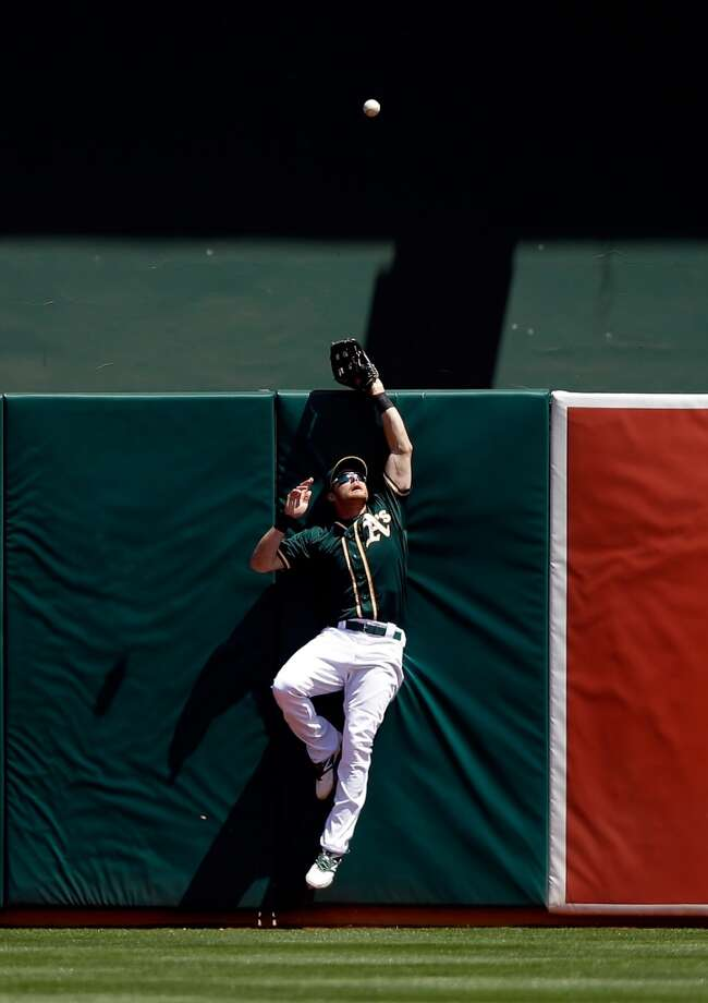 April 19: Athletics 4, Astros 3Craig Gentry #3 of the Athletics can not catch a home run ball hit by Jonathan Villar. Photo: Ezra Shaw, Getty Images