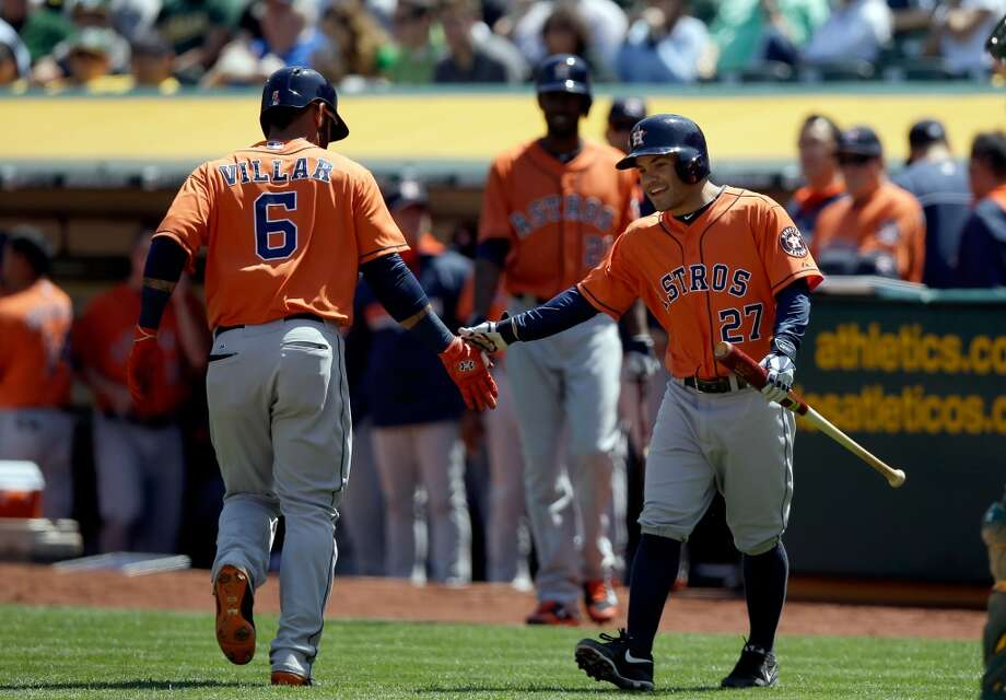 Jose Altuve #27 of the Astros congratulates Jonathan Villar #6 after Villar hit a home run. Photo: Ezra Shaw, Getty Images