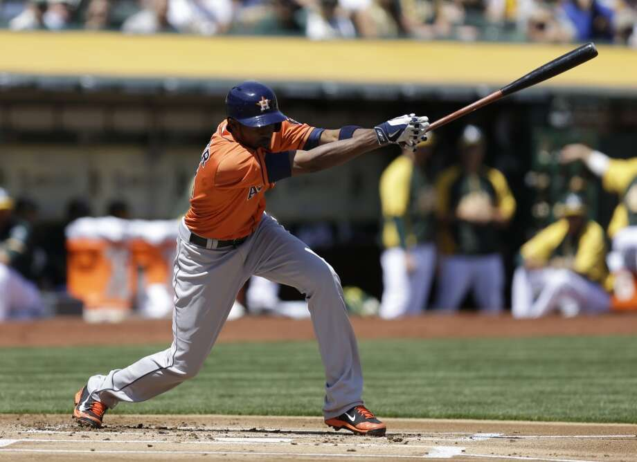 Dexter Fowler swings on a pitch. Photo: Ben Margot, Associated Press