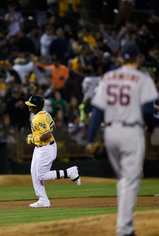 Yoenis Cespedes of the Athletics trots around the bases after hitting a solo home run off of Paul Clemens. Photo: Thearon W. Henderson, Getty Images