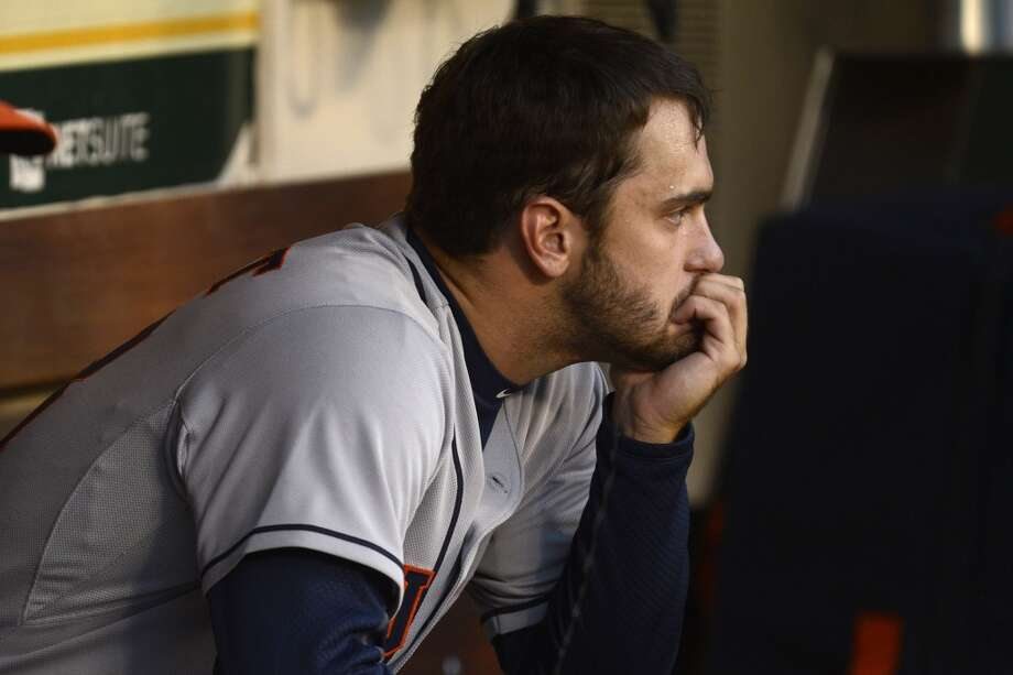 Astros pitcher Jarred Cosart sits in the dugout after being relieved. Photo: JOSE CARLOS FAJARDO, McClatchy-Tribune News Service
