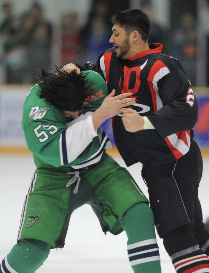 Danbury's Julian Fraser (55) fights Dayton's Brandon Blair (2) in the Federal Hockey League Commissioner's Cup Championship game between the Danbury Whalers and the Dayton Demonz at the Danbury Ice Arena in Danbury, Conn. Saturday, April 19, 2014. Photo: Tyler Sizemore / The News-Times
