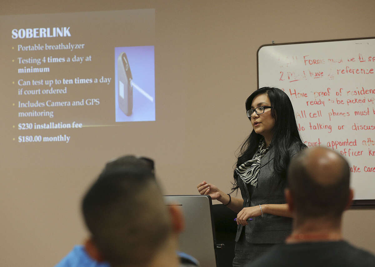 During orientation class, pretrial services bond officer Analise Abi Rached warns attendees that if they violate the terms of their ignition interlock judges could impose several expensive added safeguards to keep them from drinking.