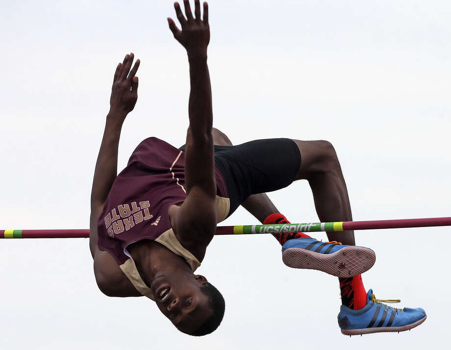 Texas State's Garrett Robinson soars over the bar to win the high jump at the UTSA Invitational on Saturday. Photo: Tom Reel / San Antonio Express-News