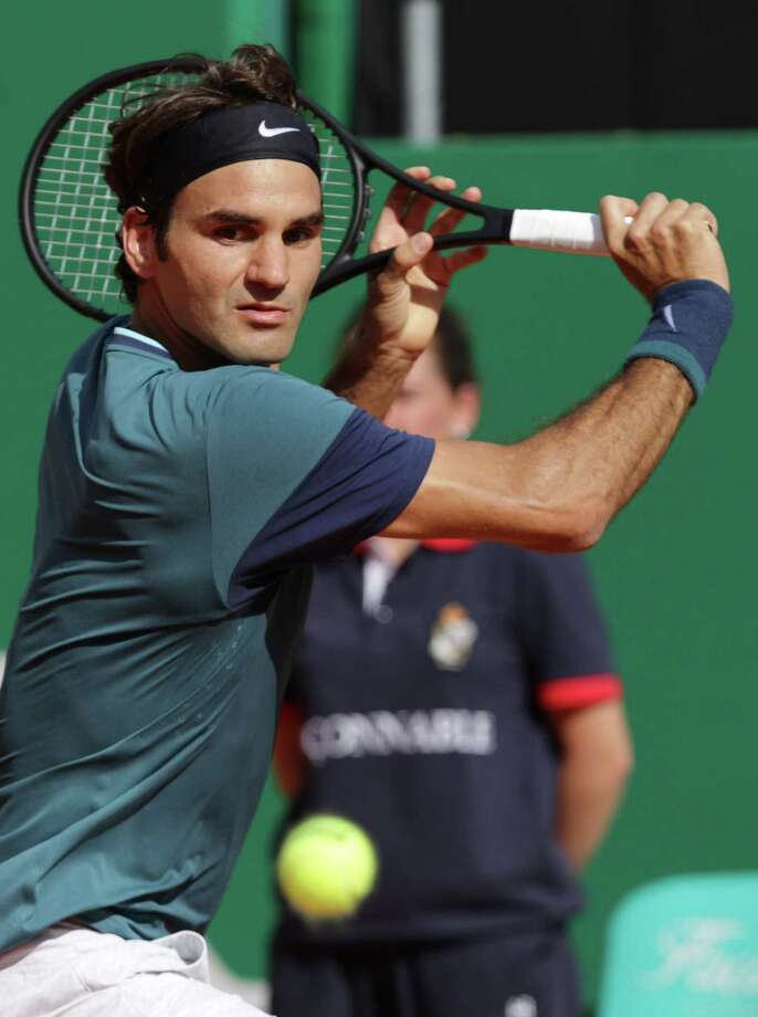 Switzerland's Roger Federer returns the ball to Serbia's Novak Djokovic during their Monte-Carlo ATP Masters Series Tournament tennis match in Monaco on April 19, 2014. AFP PHOTO / JEAN-CHRISTOPHE MAGNENETJEAN-CHRISTOPHE MAGNENET/AFP/Getty Images ORG XMIT: 479868143 Photo: JEAN-CHRISTOPHE MAGNENET / JEAN CHRISTOPHE MAGNENET