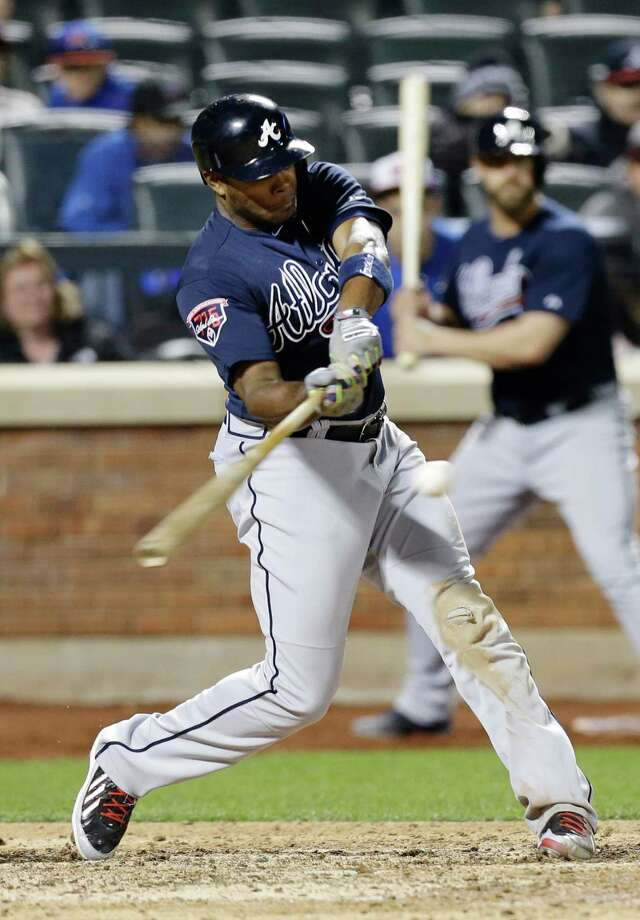 Atlanta Braves' Justin Upton hits a three-run home run during the ninth inning of a baseball game against the New York Mets, Saturday, April 19, 2014, in New York. (AP Photo/Frank Franklin II) ORG XMIT: NYM115 Photo: Frank Franklin II / AP