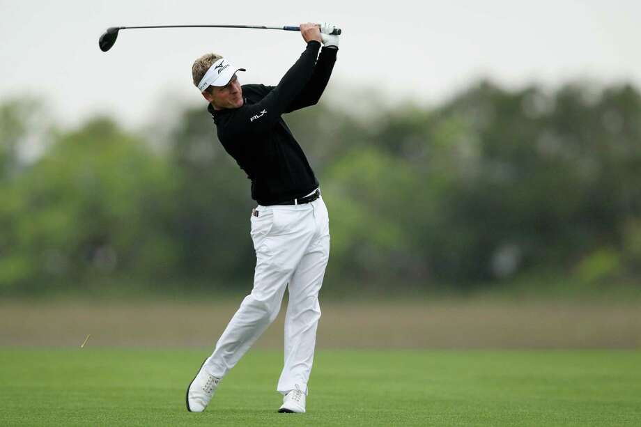 HILTON HEAD ISLAND, SC - APRIL 19:  Luke Donald of England plays a shot on the 18th hole during the third round of the RBC Heritage at Harbour Town Golf Links on April 19, 2014 in Hilton Head Island, South Carolina.  (Photo by Tyler Lecka/Getty Images) ORG XMIT: 461899143 Photo: Tyler Lecka / 2014 Getty Images