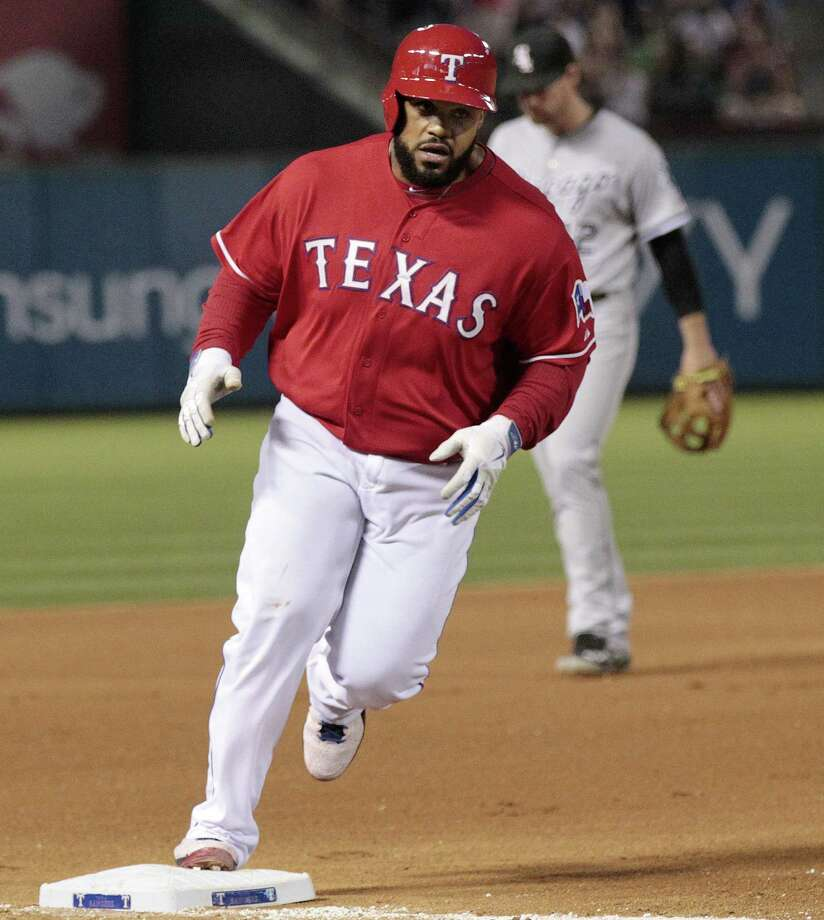 Rangers first baseman Prince Fielder rounds third after his solo home run in the fourth inning. It was the second homer of the season for Fielder, who has a .194 batting average. Photo: Ron T. Ennis / Fort Worth Star-Telegram / Fort Worth Star-Telegram