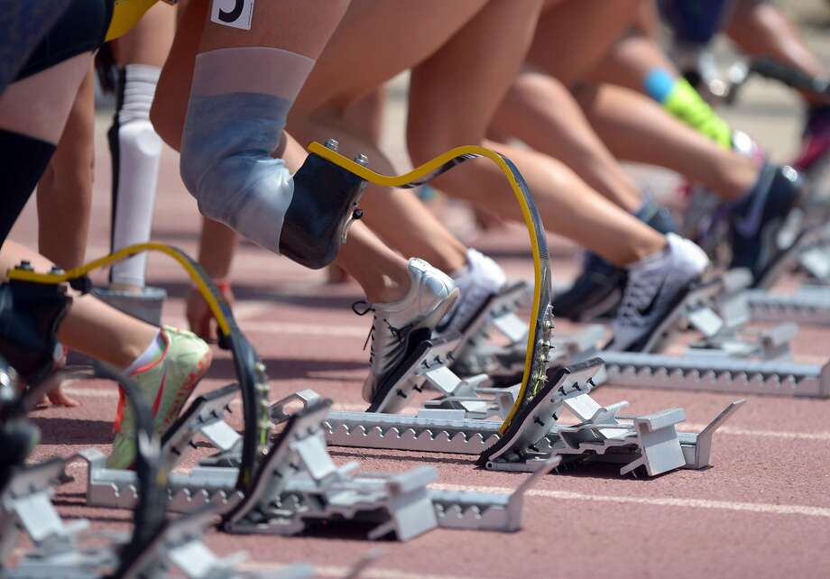Apr 19, 2014; Walnut, CA, USA; General view of the prosthetics of sprinters in the starting blocks of the womens paralympic 100m in the 56th Mt. San Antonio College Relays. Mandatory Credit: Kirby Lee-USA TODAY Sports Photo: Kirby Lee, Reuters