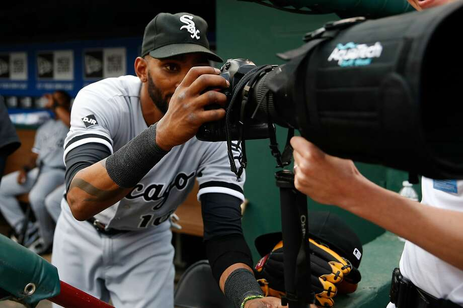 Apr 19, 2014; Arlington, TX, USA; Chicago White Sox shortstop Alexei Ramirez (10) plays with a camera before the game against the Texas Rangers at Globe Life Park in Arlington. Texas won 6-3. Mandatory Credit: Kevin Jairaj-USA TODAY Sports Photo: Kevin Jairaj, Reuters