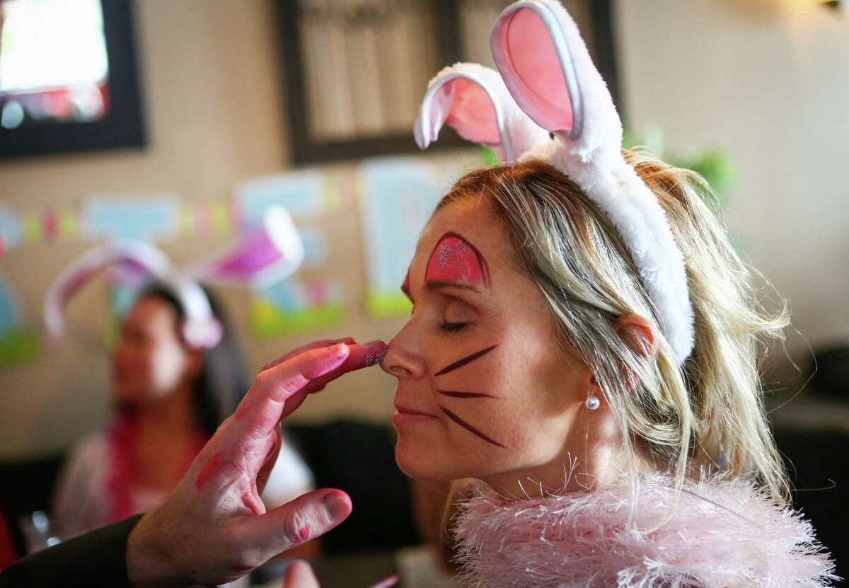A participants has her nose painted during BunnyCon, a bunny-themed bar hop, on Saturday, April 19, 2014. Hundreds of floppy-eared people walked between downtown Seattle bars during the event.