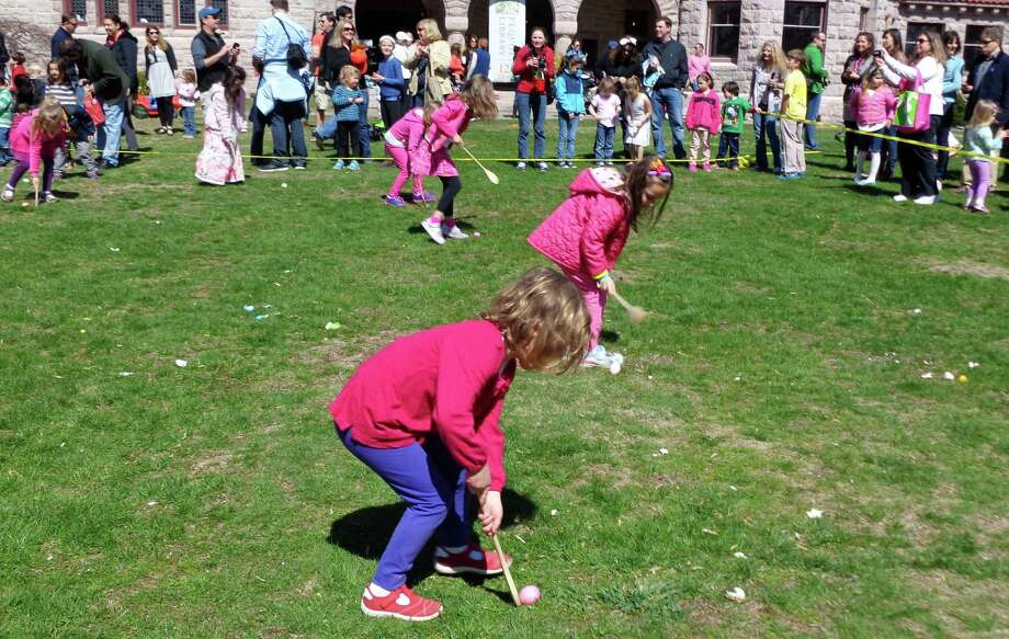 Hundreds turned out under sunny spring skies Saturday for the 8th annual Egg Roll on the Great Lawn of the Pequot Library. Photo: Meg Barone / Fairfield Citizen
