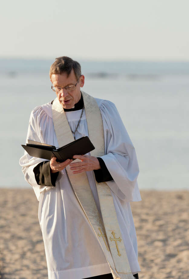 Rev. Jack Breznen, Pastor, Trinity Lutheran Church, delivers an Easter greeting during the annual sunrise Easter service at the East Pavilion at Cove Island Park in Stamford on Sunday, Apr. 20, 2014. The Easter Sunrise Service is a tradition among Christian people around the world. The Service at Cove Beach has become a local tradition, annually sponsored by Trinity Lutheran Church for the residents of Stamford, Darien, New Canaan and neighboring communities. Photo: Amy Mortensen / Connecticut Post Freelance