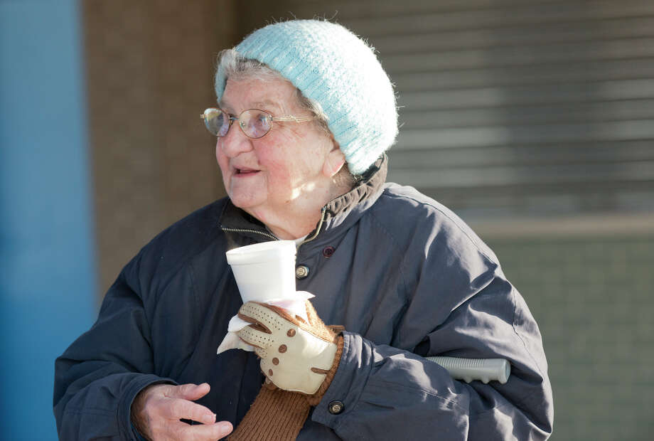 Virginia Kristoff, of Stamford, enjoys a hot cup of coffee following the annual sunrise Easter service at the East Pavilion at Cove Island Park in Stamford on Sunday, Apr. 20, 2014. The Easter Sunrise Service is a tradition among Christian people around the world. The Service at Cove Beach has become a local tradition, annually sponsored by Trinity Lutheran Church for the residents of Stamford, Darien, New Canaan and neighboring communities. Photo: Amy Mortensen / Connecticut Post Freelance