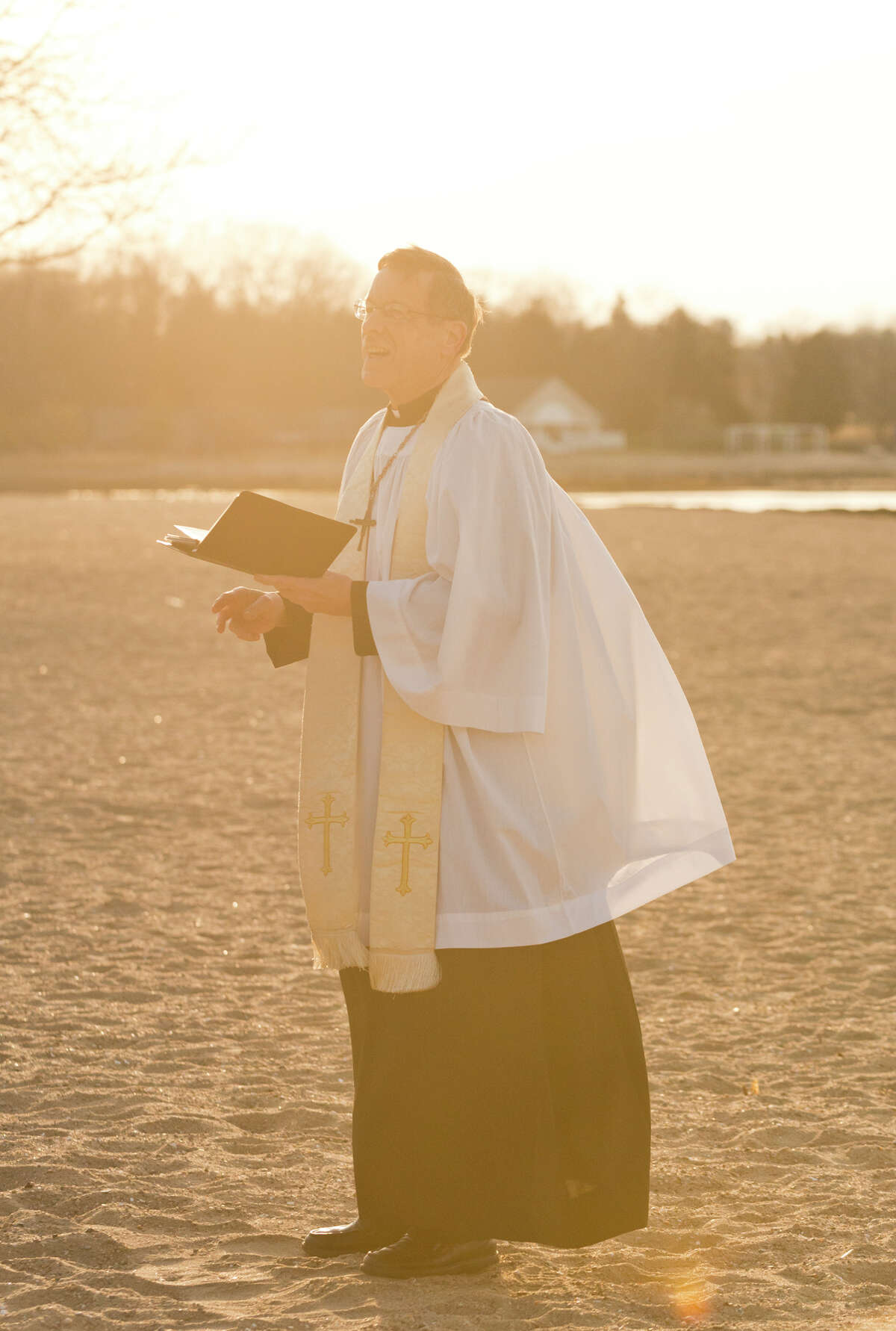 Rev. Jack Breznen, Pastor, Trinity Lutheran Church, delivers an Easter greeting during the annual sunrise Easter service at the East Pavilion at Cove Island Park in Stamford on Sunday, Apr. 20, 2014. The Easter Sunrise Service is a tradition among Christian people around the world. The Service at Cove Beach has become a local tradition, annually sponsored by Trinity Lutheran Church for the residents of Stamford, Darien, New Canaan and neighboring communities.
