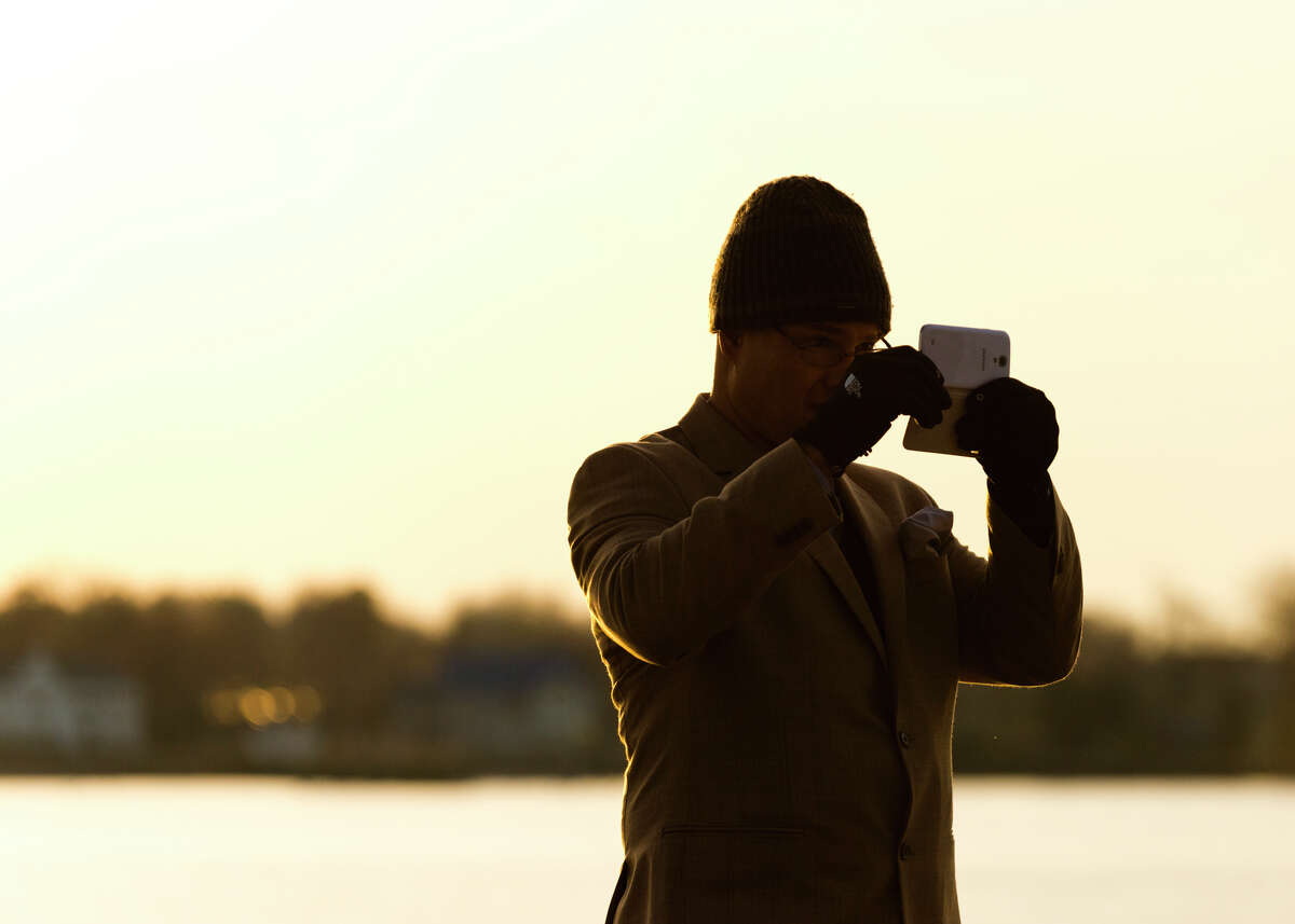 Charles Herring, of Stamford, takes a panoramic photo at Cove Island Park in Stamford on Sunday, Apr. 20, 2014.