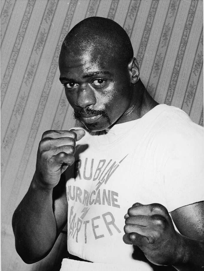 """Rubin 'Hurricane' Carter, 1937-2014: The boxer's wrongful murder conviction became an international symbol of racial injustice. He spent 19 years in prison for three murders at a tavern in Paterson,  New Jersey, in 1966, and was freed in 1985 when his convictions were set aside after years of  appeals and public advocacy. His ordeal and the alleged racial  motivations behind it were publicized in Bob Dylan's 1975 song  """"Hurricane,"""" several books and a 1999 film starring Denzel Washington. Carter died on April 20 after battling prostate cancer at age 76. Photo: FPG, Getty Images / 2005 Getty Images"""