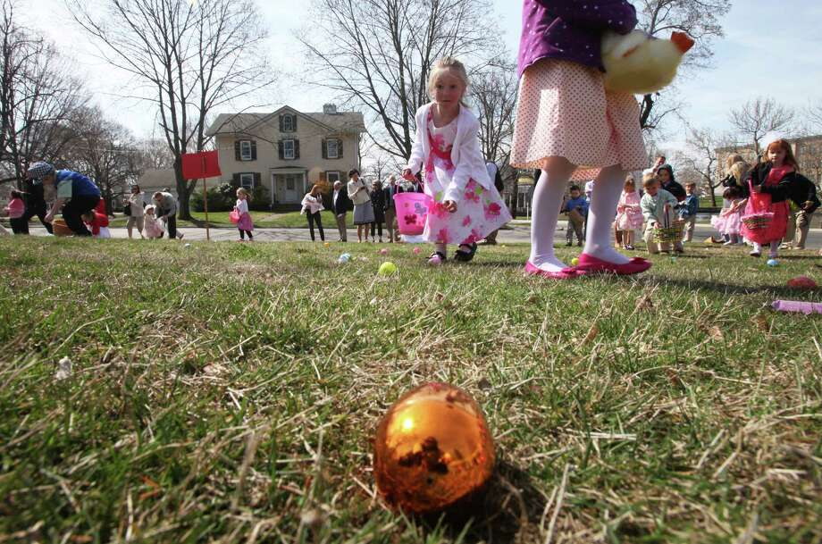 Children gather eggs after an Easter Service at the First United Church of Christ Congregational in Milford on Sunday, April 20, 2014. Photo: BK Angeletti, B.K. Angeletti / Connecticut Post freelance B.K. Angeletti