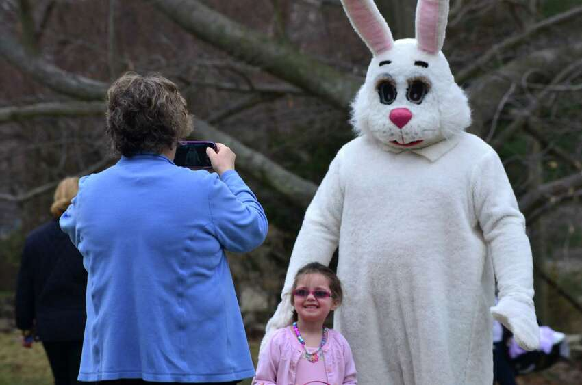 The Easter egg hunt slowed after the arrival of the Easter Bunny on the Darien Community Association front lawn on Friday, April 11.