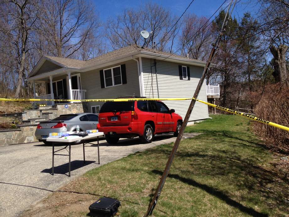 One man was wounded and another was in custody Sunday, April 20, 2014, following a shooting in a hilltop home on Woodbridge Avenue.
