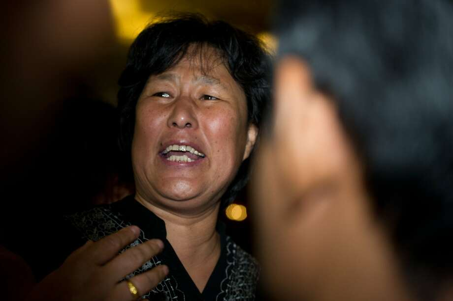 "A Chinese relative (C) of passengers onboard missing Malaysia Airlines (MAS) flight MH370 reacts as she arrives during a briefing at a hotel in Kuala Lumpur on April 20, 2014.  The effort to find missing flight MH370 is at a ""very critical juncture"", Malaysia's transport minister said on April 19 as authorities mull whether to reassess a challenging search of the Indian Ocean seabed that has so far found nothing. AFP PHOTO / MOHD RASFANMOHD RASFAN/AFP/Getty Images Photo: Mohd Rasfan, AFP/Getty Images"