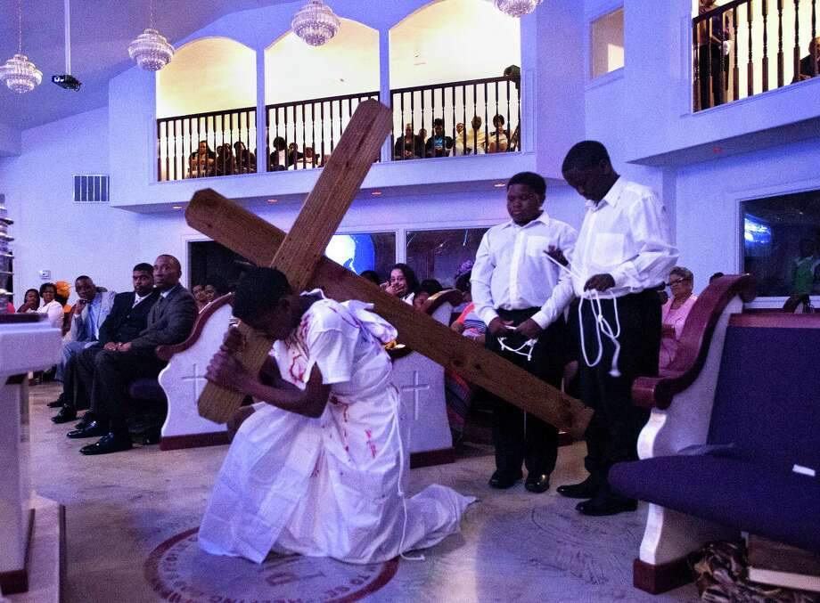 Jaden Ratcliff, 12, left, Jason Ratcliff, 10, center, and Diamonte Nelson, 12, right, reenact Jesus carrying the cross during an Easter Sunday sermon at Providence Missionary Baptist Church, Sunday, April 20, 2014, in Houston. Photo: Cody Duty, Houston Chronicle / © 2014 Houston Chronicle