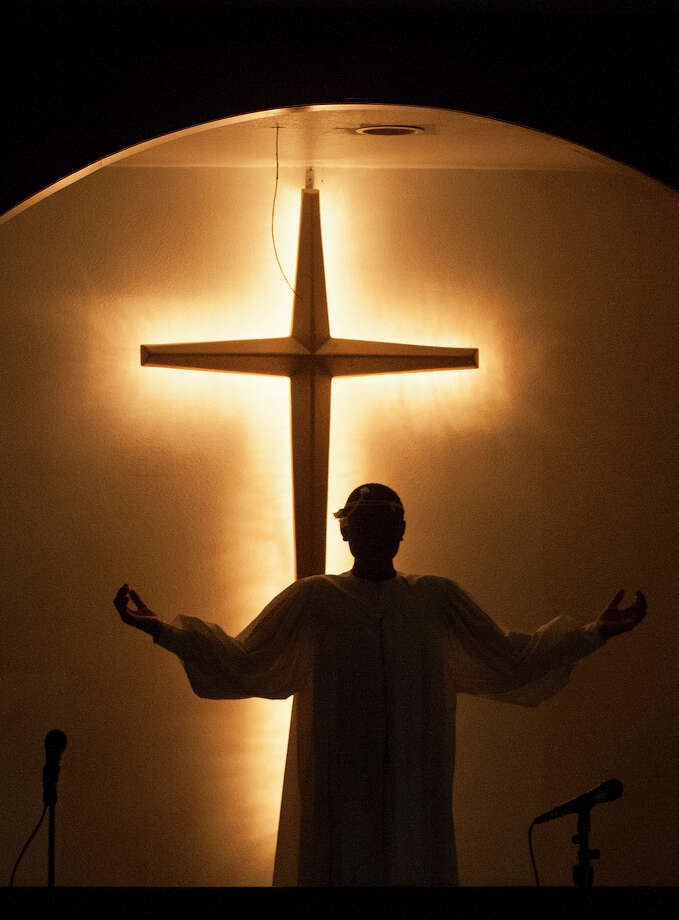 Jaden Ratcliff, 12, stands in front of the cross to resemble Jesus during an Easter Sunday sermon at Providence Missionary Baptist Church, Sunday, April 20, 2014, in Houston. Photo: Cody Duty, Houston Chronicle / © 2014 Houston Chronicle