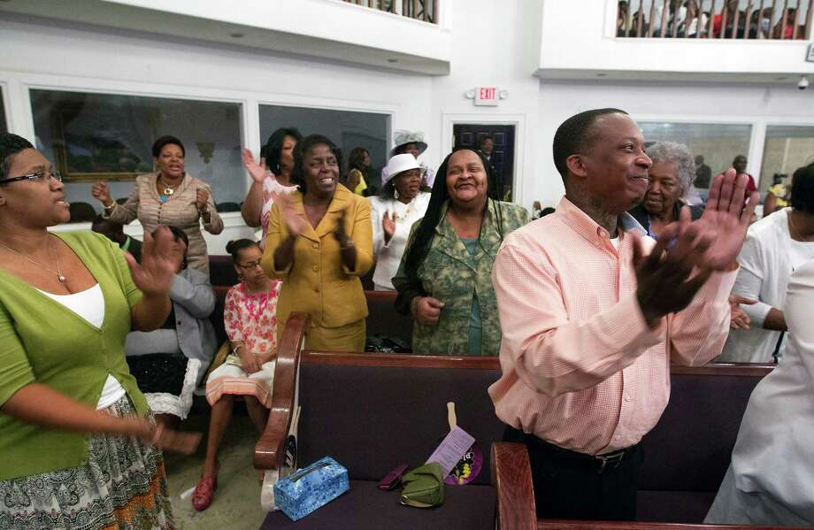 Members of the congregation worship during an Easter Sunday ceremony at Providence Missionary Baptist Church, Sunday, April 20, 2014, in Houston. Photo: Cody Duty, Houston Chronicle / © 2014 Houston Chronicle