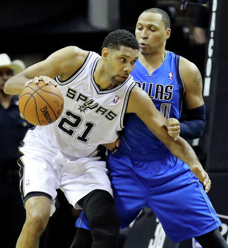 San Antonio Spurs' Tim Duncan looks for room around Dallas Mavericks' Shawn Marion during first half action of Game 1 in the first round of the Western Conference playoffs Sunday April 20, 2014 at the AT&T Center. Photo: Edward A. Ornelas, . / © 2014 San Antonio Express-News