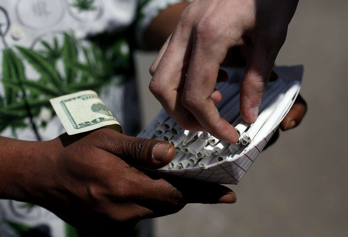 An entrepreneur sells pre-rolled joints during 420 celebrations at Hippie Hill in Golden Gate Park in San Francisco, Calif., on Sunday, April 20, 2014.