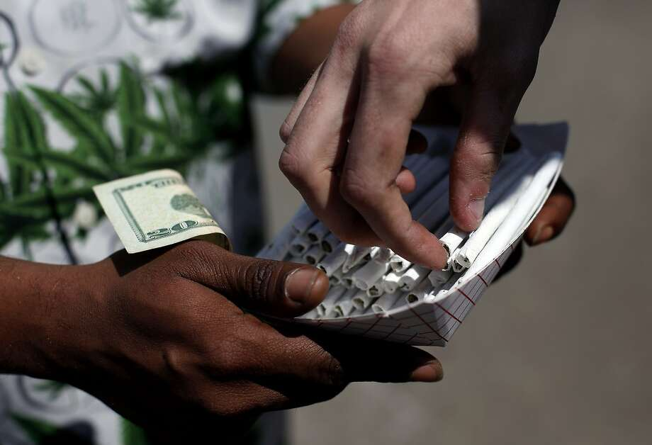 An entrepreneur offers joints for sale during the 4/20 celebration in Golden Gate Park. Photo: Sarah Rice, Special To The Chronicle