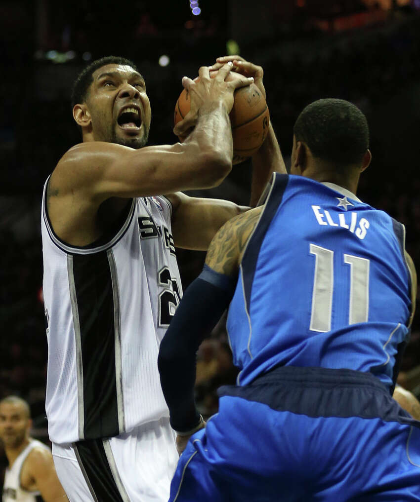 San Antonio Spurs' Tim Duncan drives around the defense of Dallas Mavericks' Monta Ellis during the first half of game one in the first round of the Western Conference Playoffs at the AT&T Center, Sunday, April 20, 2014.