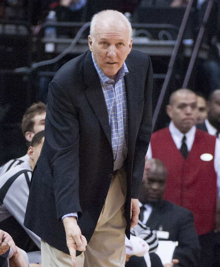 Head coach Gregg Popovich of the San Antonio Spurs gives instructions to his team against the Houston Rockets in the first half of their game on Monday, April 14, 2014, in Houston. (George Bridges/MCT) Photo: George Bridges, McClatchy-Tribune News Service