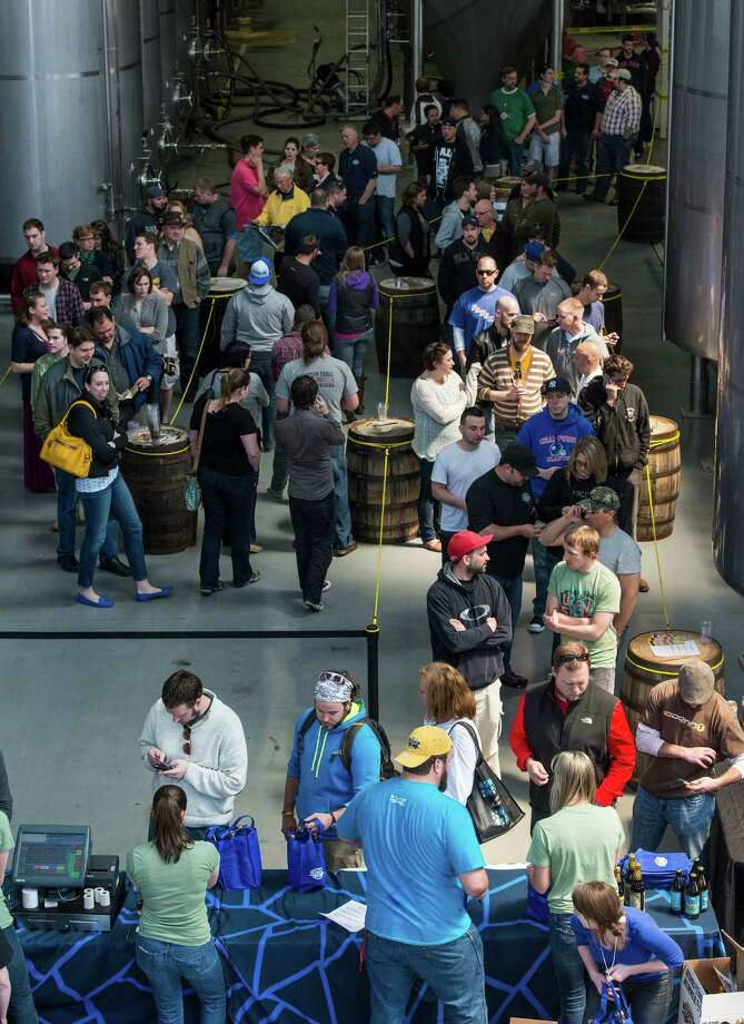 "A long line of customers waiting to pick up their limited edition beer at the ""NorâÄôYeaster"" limited edition beer release event at Two Roads Brewing Company, Stratford CT on Saturday, April, 19th, 2014. The brewery was releasing a limited supply of three different beers, Two Roads Krazy Pucker, HenryâÄôs Farm Double Bock Lager Aged in Rye Whiskey Barrels and Urban Funk Wild Ale. Photo: Mark Conrad / Connecticut Post Freelance"