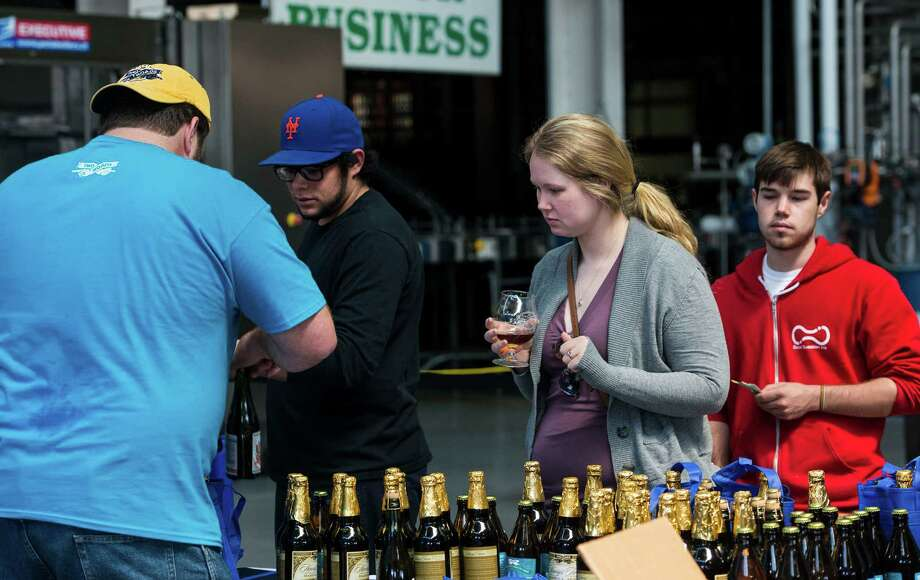 "Customers pick up their limited edition beer at the ""NorâÄôYeaster"" limited edition beer release event at Two Roads Brewing Company, Stratford CT on Saturday, April, 19th, 2014. The brewery was releasing a limited supply of three different beers, Two Roads Krazy Pucker, HenryâÄôs Farm Double Bock Lager Aged in Rye Whiskey Barrels and Urban Funk Wild Ale. Photo: Mark Conrad / Connecticut Post Freelance"