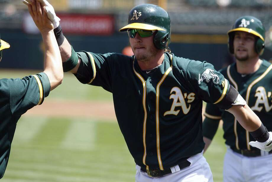 Oakland Athletics' Josh Donaldson celebrates his first-inning two-run homer during a baseball game against the Houston Astros in Oakland, Calif. on Sunday, April 20, 2014. (AP Photo/Mathew Sumner) Photo: Mathew Sumner, Associated Press