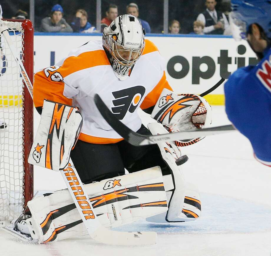 Flyers goalie Ray Emery keeps the puck out of the net during Philadelphia's Game 2 victory. Photo: Paul Bereswill, Getty Images