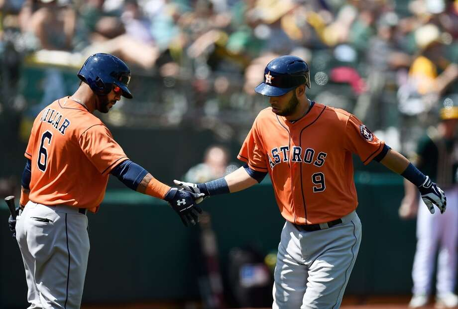 Marwin Gonzalez is congratulated by Jonathan Villar after Gonzalez hit a solo home run in the top of the fourth inning. Photo:  Thearon W. Henderson, Getty Images