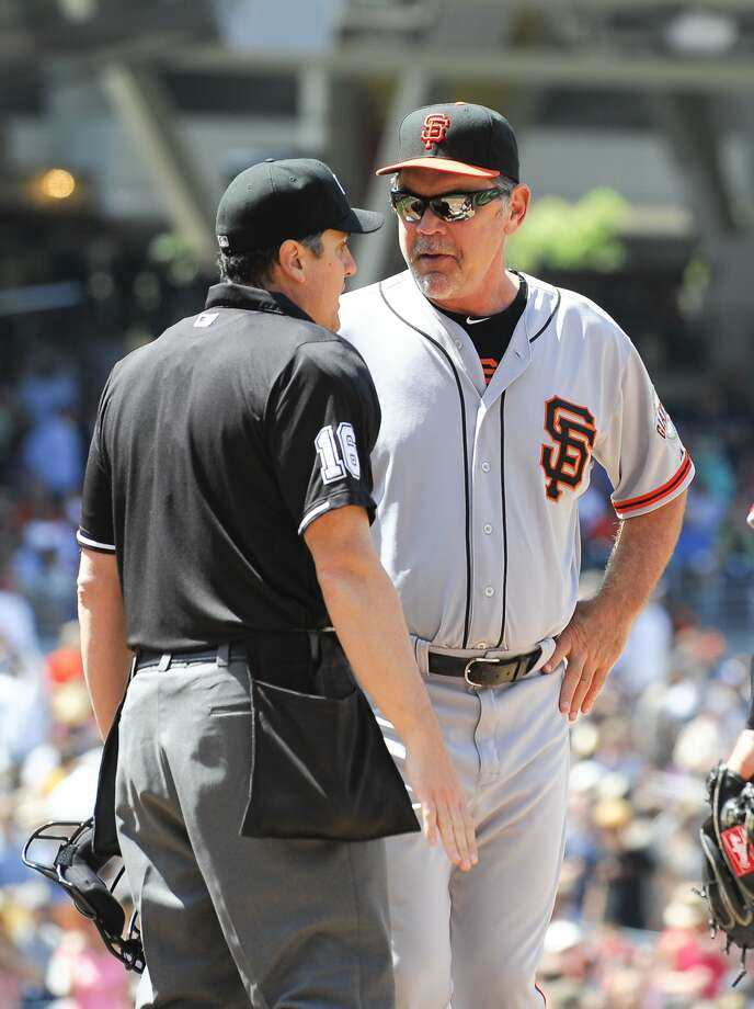 "Manager Bruce Bochy's successful challenge took away a Padres run. ""I've said I like replay, and that changed the game today,"" he said. Photo: Denis Poroy, Getty Images"