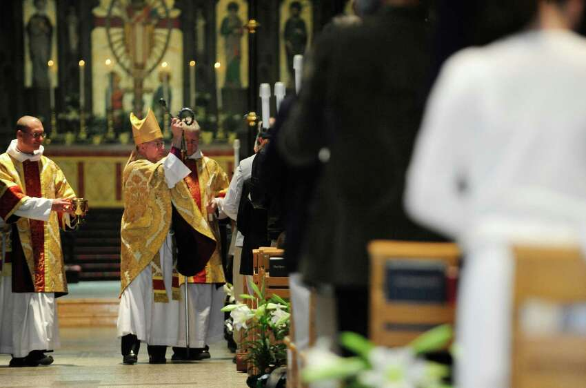 Episcopal Bishop of Albany, William Love, blesses the congregation during Easter Sunday service at the Cathedral of All Saints Episcopal church on Sunday, April 20, 2014, in Albany, N.Y. (Paul Buckowski / Times Union)