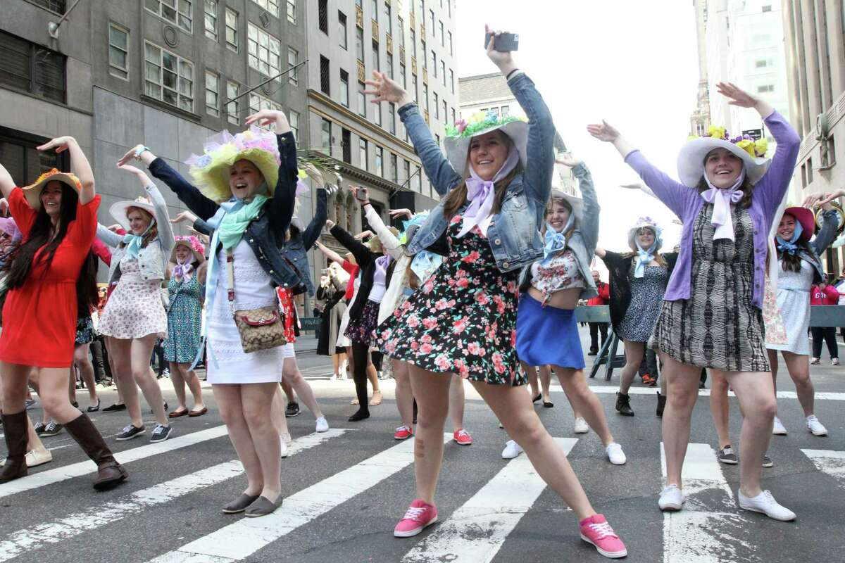 Dressed for the occasion, a dance group from Rolling Meadows High School in Rolling Meadows, Illinois, perform on New York's Fifth Avenue as they take part in the Easter Parade, Sunday, April 20, 2014. (AP Photo/Tina Fineberg) ORG XMIT: NYTF110