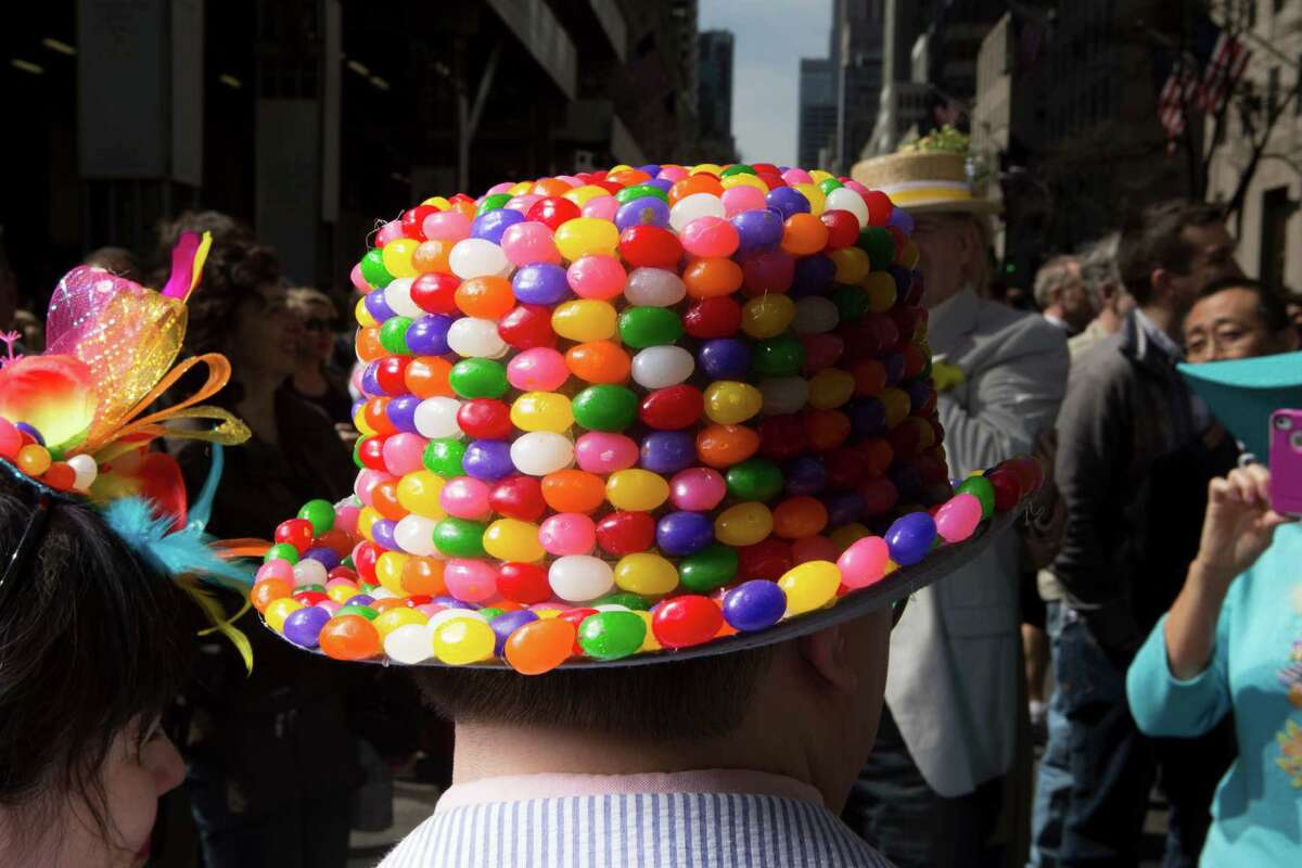 A jelly bean bowler atop one stroller's head at the annual Easter Parade and Bonnet Festival, which fills Fifth Avenue between 49th and 57th Streets, in New York, April 20, 2014. The stroll, thought to date back to the late 1800s, now draws participants sporting outfits that that run the gamut from traditional to outrageous. (Fred R. Conrad/The New York Times) ORG XMIT: XNYT60