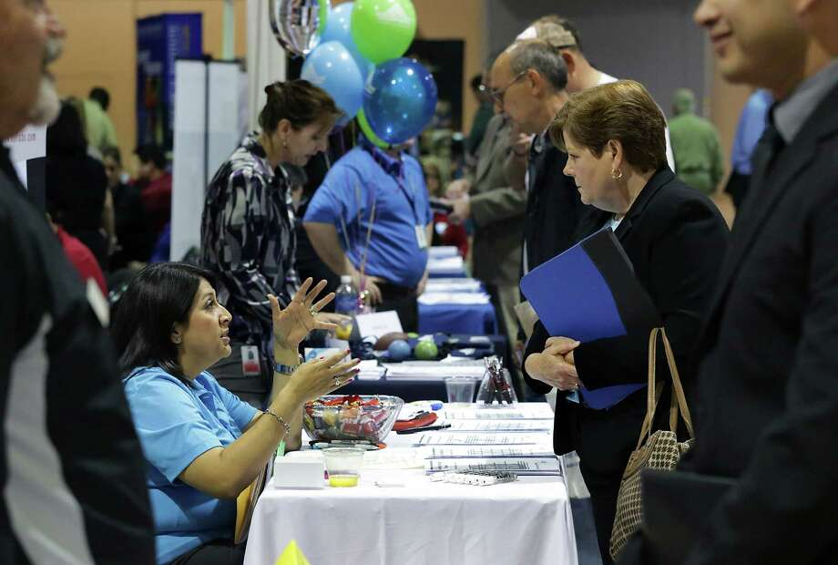 Jennifer Soto, left, counsels Denise Craigen, a military wife, at the Veterans Information Village and Military Job Fair in San Antonio. Photo: BOB OWEN, Staff / © 2012 San Antonio Express-News