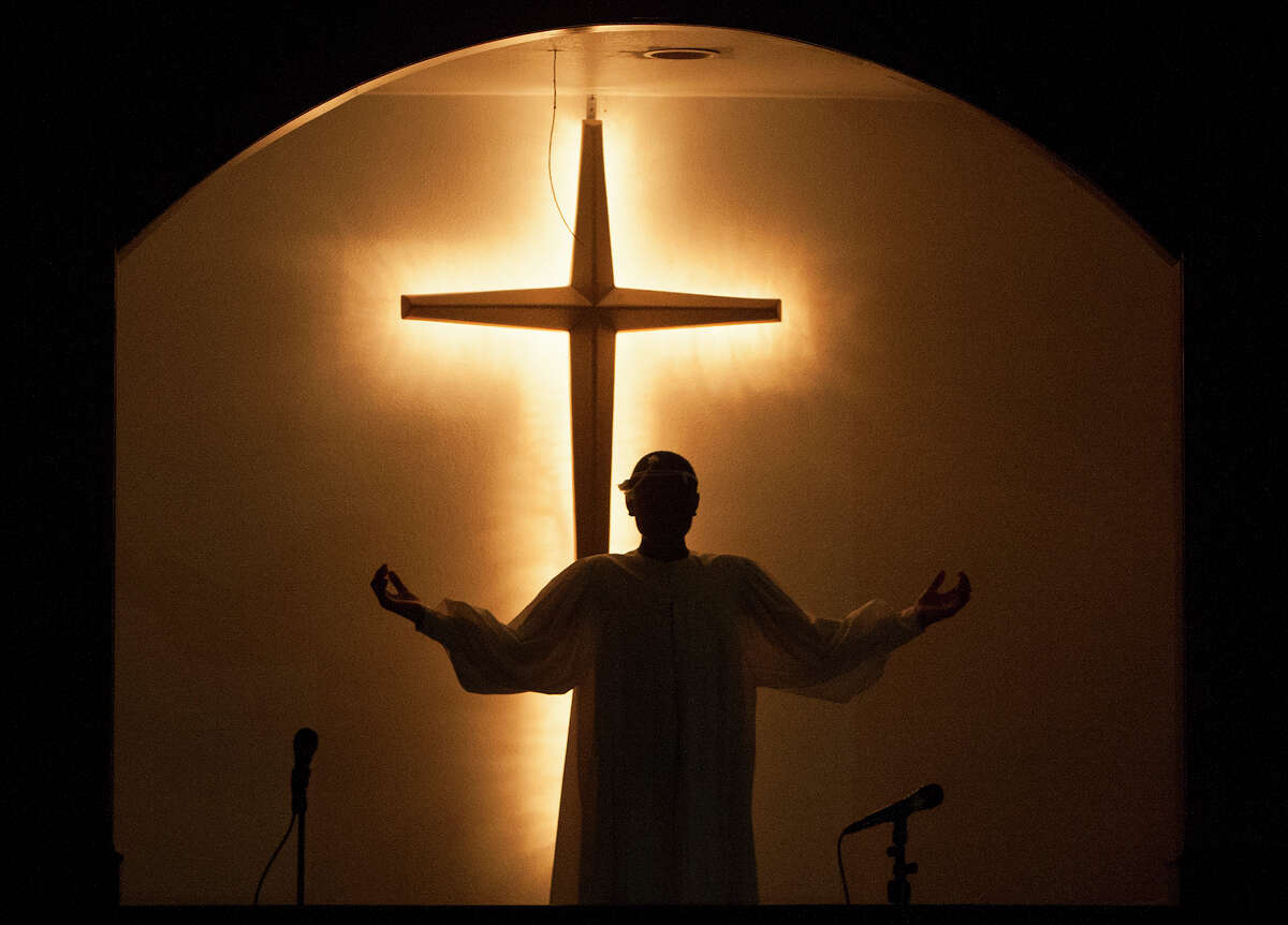 Jaden Ratcliff, 12, mimics Jesus' resurrection during an Easter performance at Providence Missionary Baptist Church.